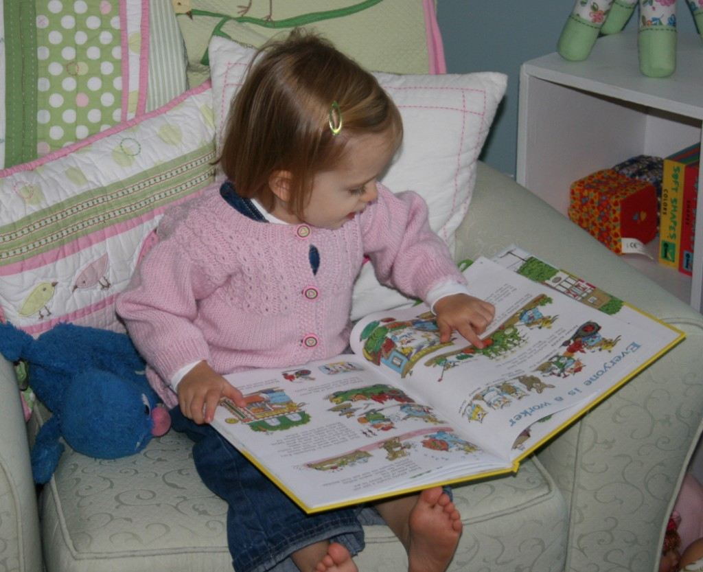 My kids just love to read!  (She is totally engrossed in Richard Scarry's What Do People Do all Day)