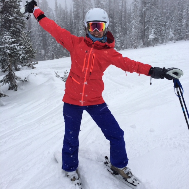 Day-Glo girl hitting the mountain.