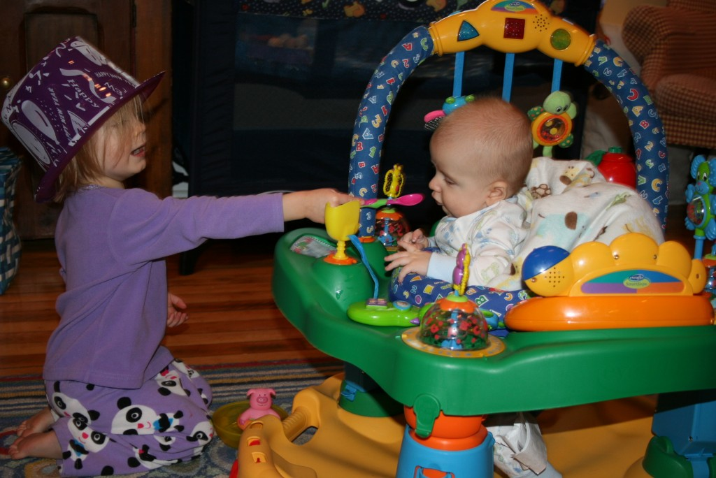 Who Loves YoBaby? Big sister practicing feeding her baby brother. | Organic Runner Mom