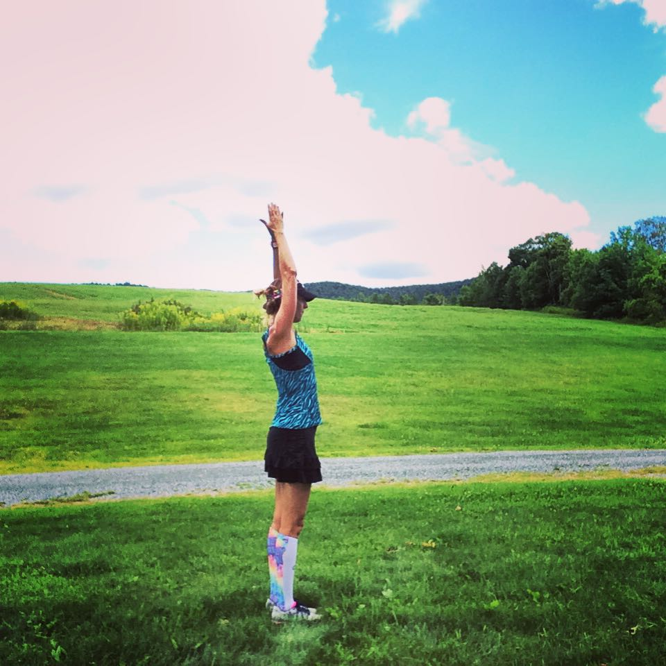 Stay calm on race day. Try some pre-race sun salutations.