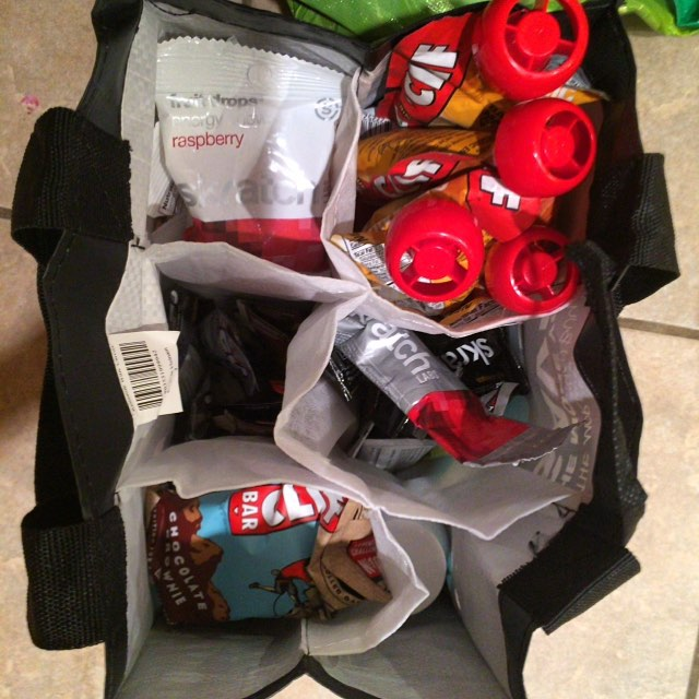 Race Day Packing Hack: Use a Grocery Store Wine Bag to organize your race day supplies such as food, tools etc.