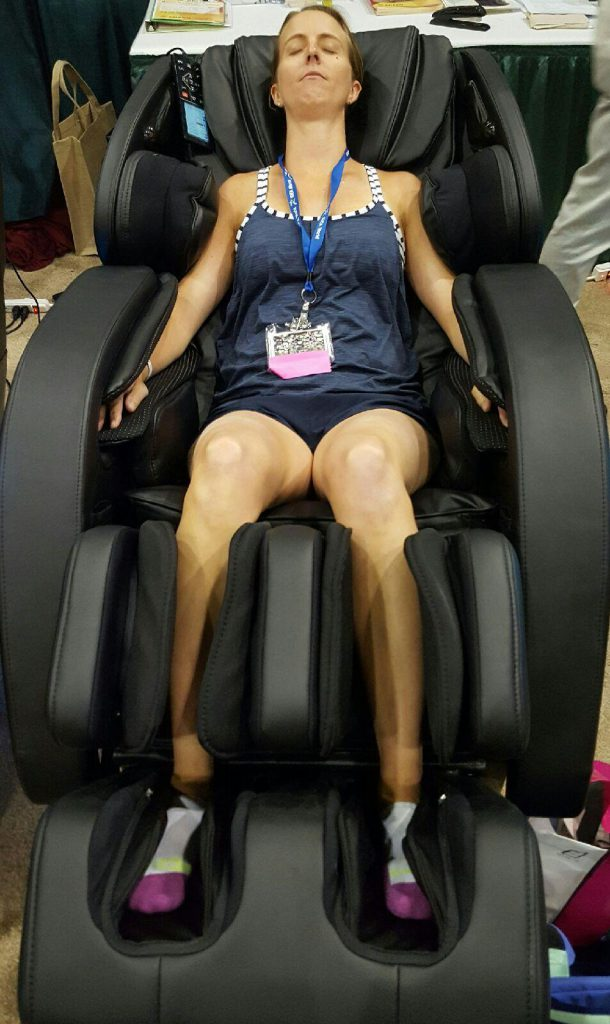 Is it time for a nap? Trying out the massage chairs at the expo.