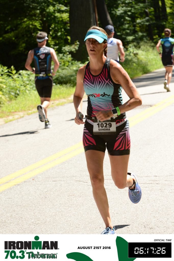 I look tired here but actually felt pretty good! Timberman Half Ironman Run