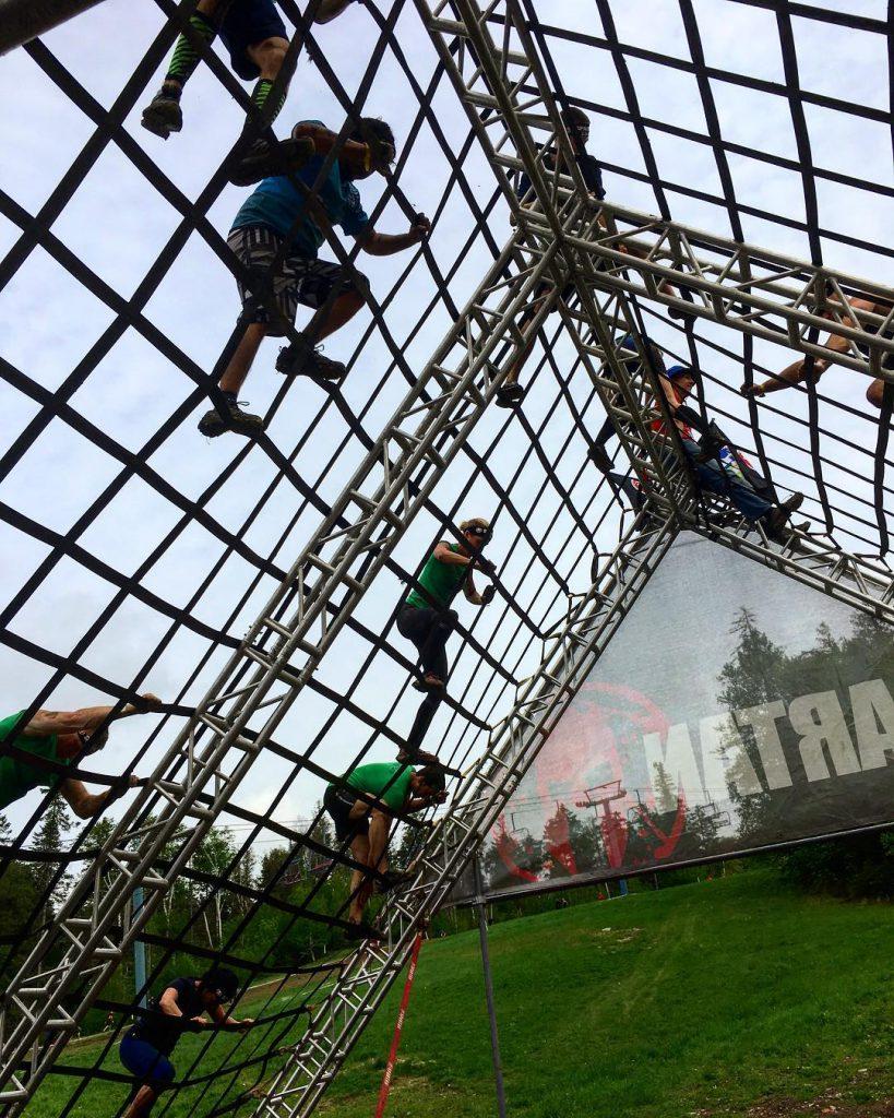 Climbing over the A-Frame Cargo net